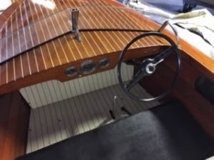 1950 17 ft. Chris Craft Special Runabout, windshield, dashboard, and steering wheel.